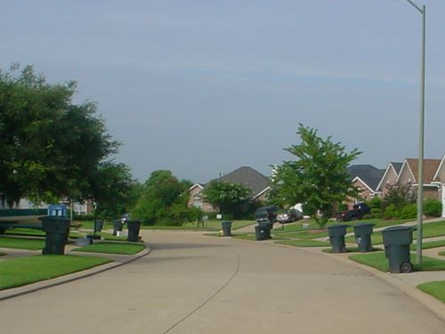 Neighborhood With Trash Receptacles Out